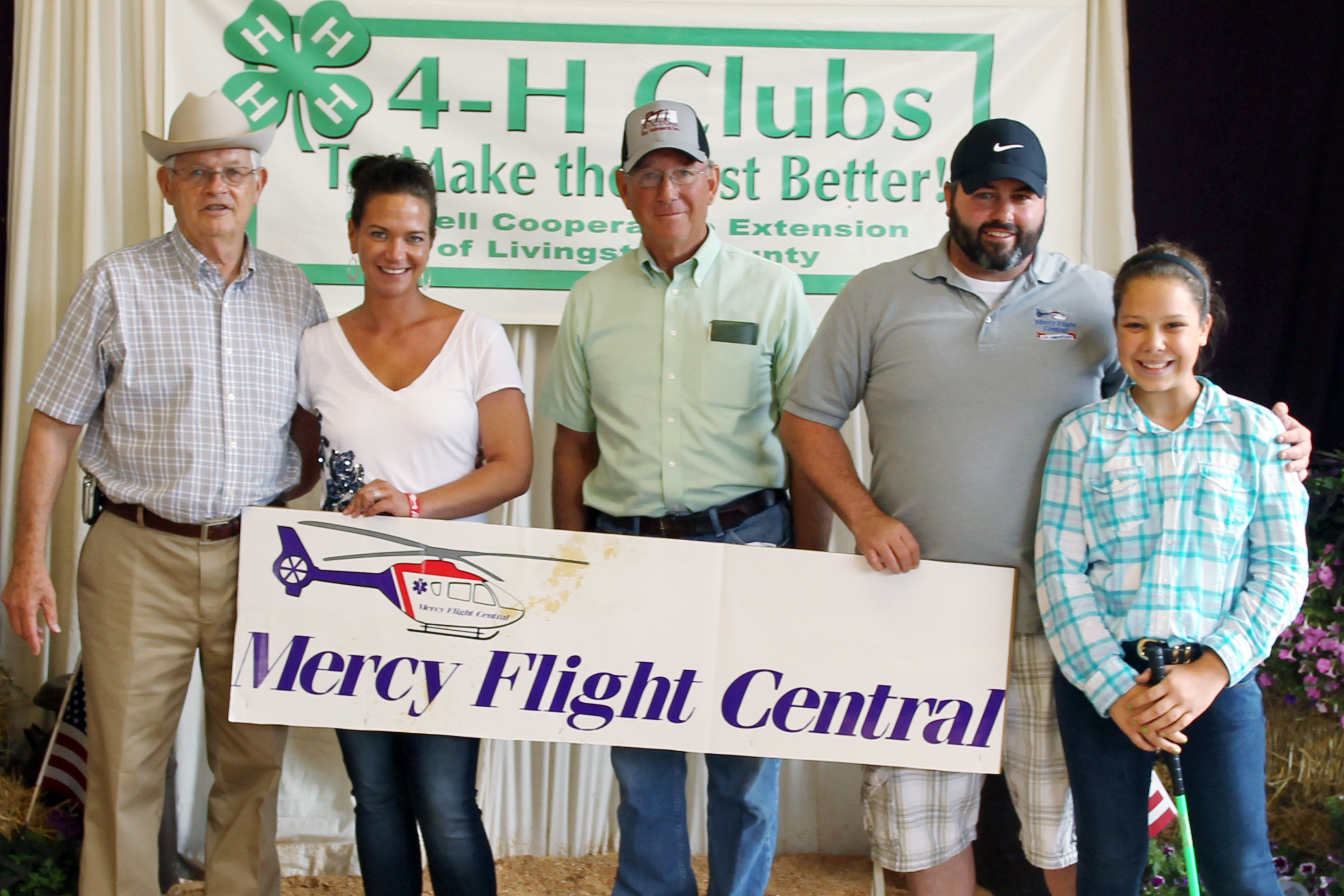 Emily Cooper continues 4-H charity work with Mercy Flight donation