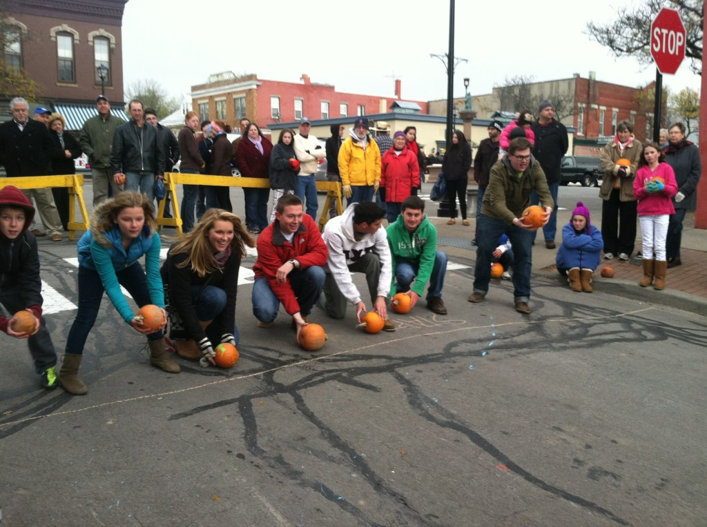 Participants in the Pumpkin roll on Bank Street.