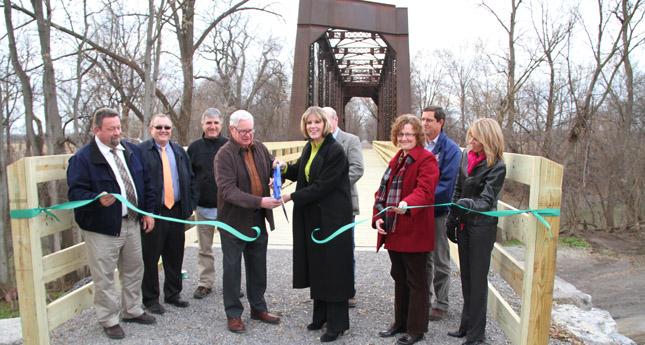 New York State Senator Catharine Young cuts the ribbon in front the bridge. (Photo/ Josh Williams)