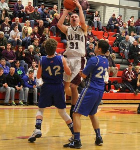 Will VanAuken shoots over two defenders (Photo credit: A.J. Devine)