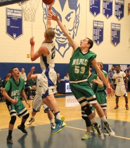 Jake Clar goes up for a contested layup
