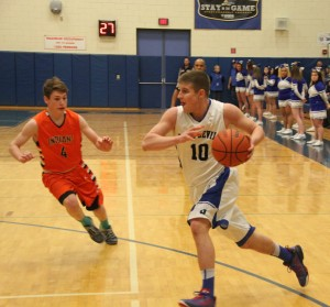 Jimmy Root drives baseline against Keshequa (Photo credit: A.J. Devine)
