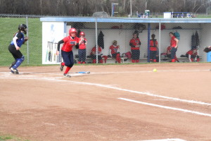 Hornell outfielder Carrie Conner attepts to run out a bunt attempt (Photo credit: A.J. Devine)