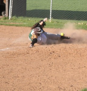 Cal-Mum 3B Courtney Flagler slides into home as Avon P Katie Renner attempts to tag her out (Photo credit: A.J. Devine)