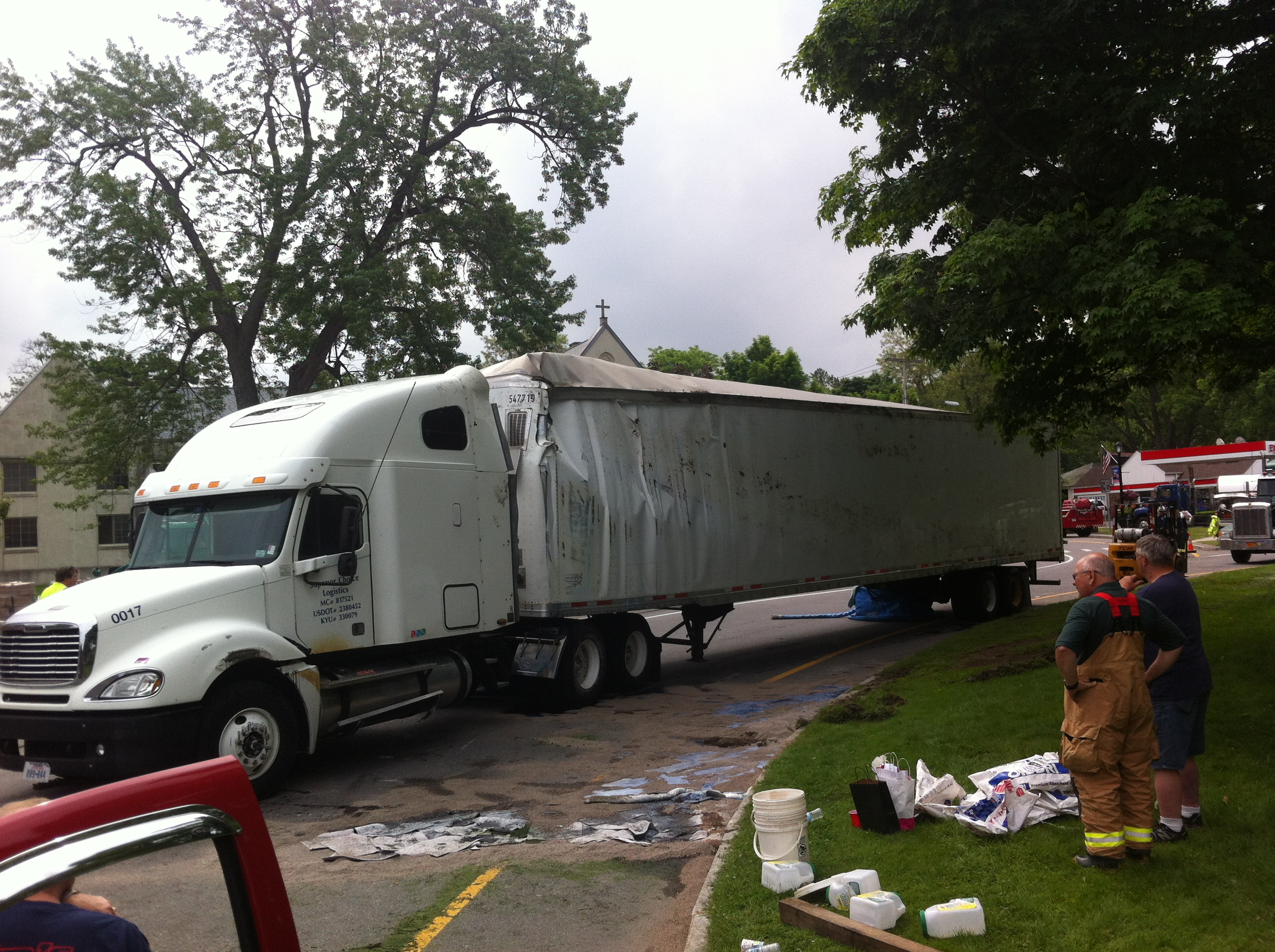 Avon Tractor Trailer Capsizes on Circle, Driver Ticketed