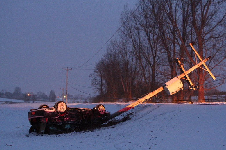 Young Man Walks Away After Downing Pole in Rollover
