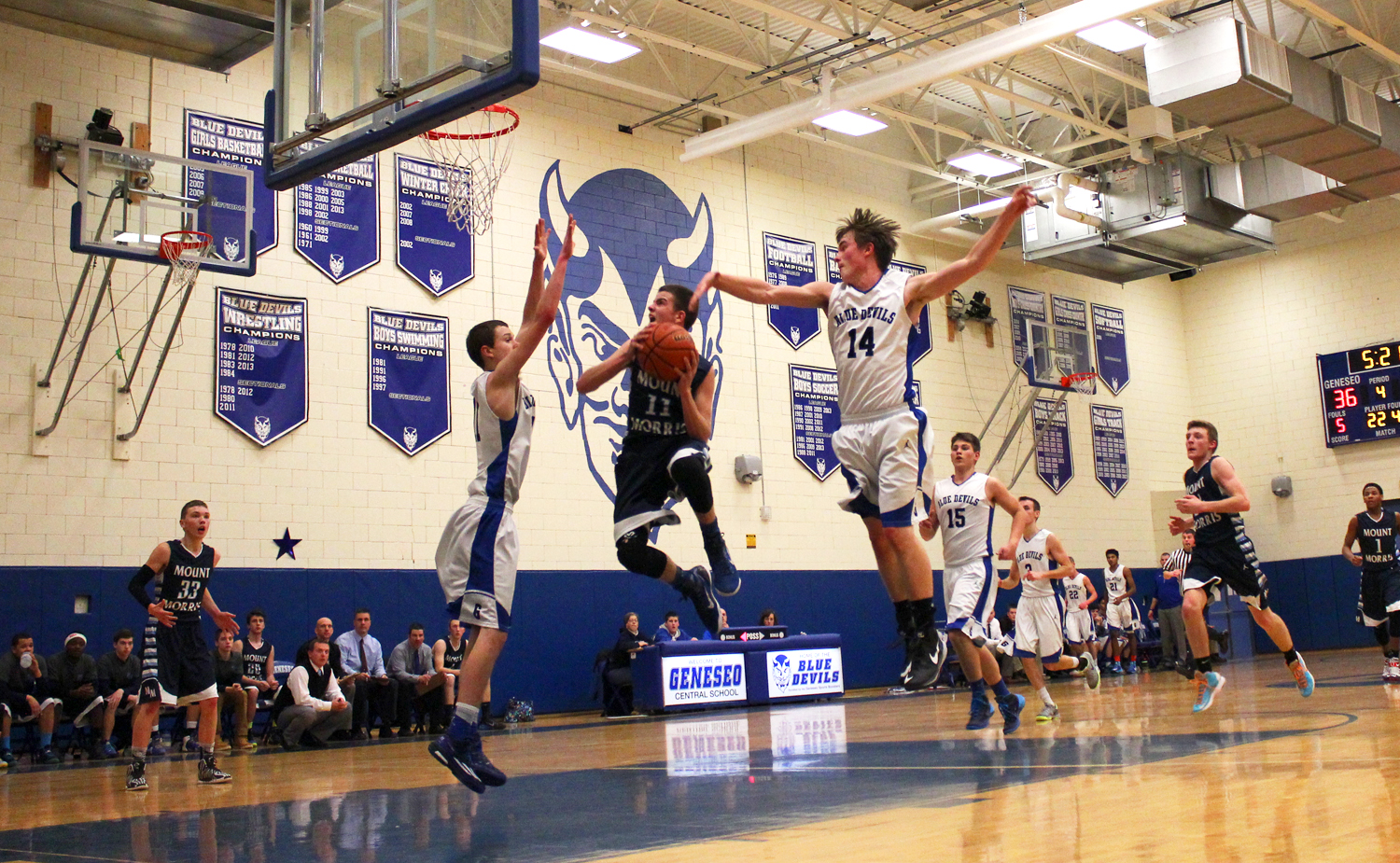 BOYS BASKETBALL: Mount Morris Defeats Geneseo On Home Turf