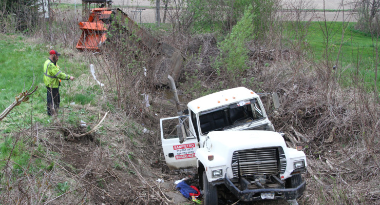 Driver of Garbage Truck in Accident Identified and in Critical Condition