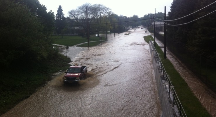 Disaster Strikes as Flash Flood Washes out Spring Street and Others