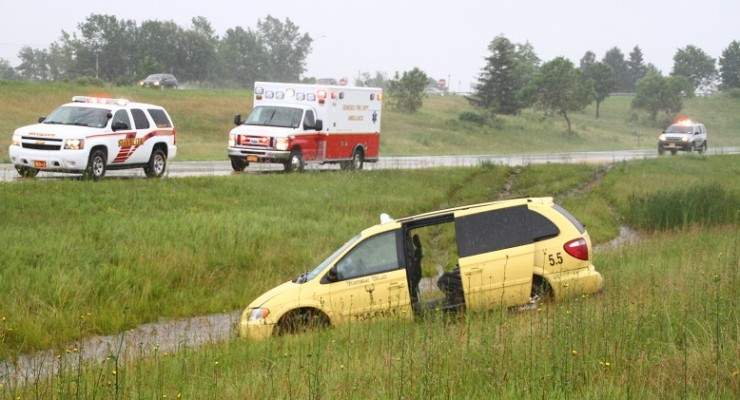 Taxi Carrying Passenger Hydroplanes on 390 Near Geneseo