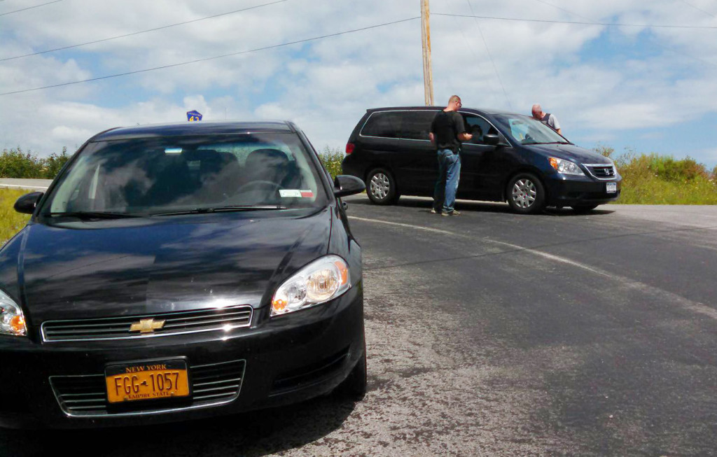 Law enforcement officials stop a car at one of the check points they have set up. (Photo/ Conrad Baker)