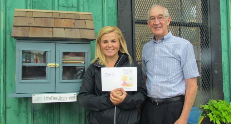 GCS Grad Cuts Ribbon at Little Free Library in Highland Park Geneseo