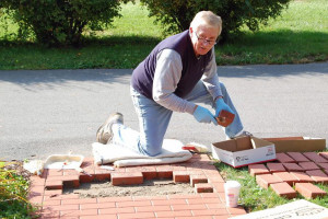 Bob Schiltz doing volunteer work with the bricks. (Photo Provided)