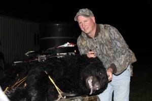 Scott Cripps with the bear he shot in Groveland. (Photo/ Glenn Staley)