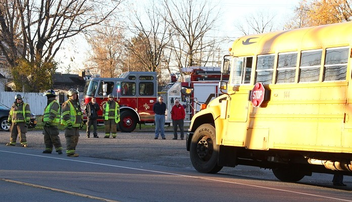 Elderly Driver Backs into School Bus in Lakeville