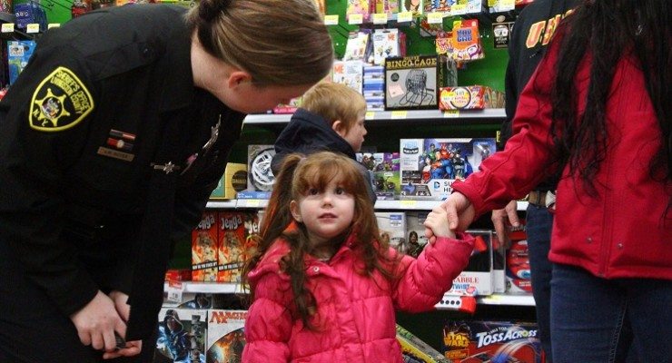 Tiny Tots' Eyes All Aglow Christmas Toy Shopping with Cops