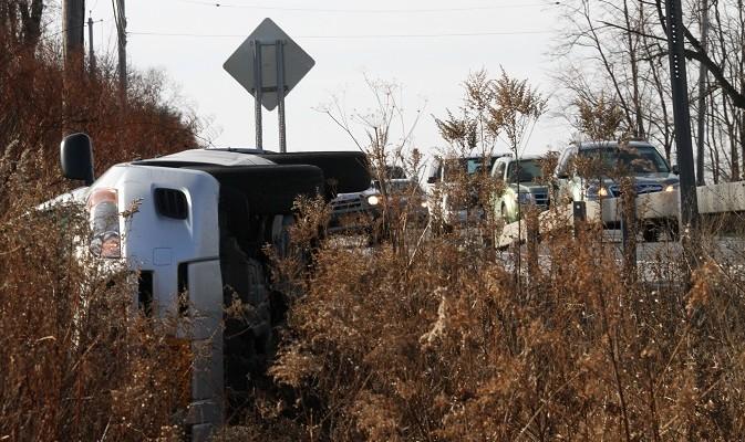 Striking Guard Rail Rolls SUV in Geneseo