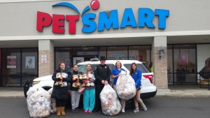Pictured is Livingston County Sheriff's Office Community Policing Deputy Michael Didas with Pet Smart employees and customers who were involved with the donations. (Photo/Livingston County Sheriff's Office)