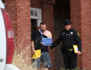 Mosher being led from Livonia Town court. (Photo/Conrad Baker)