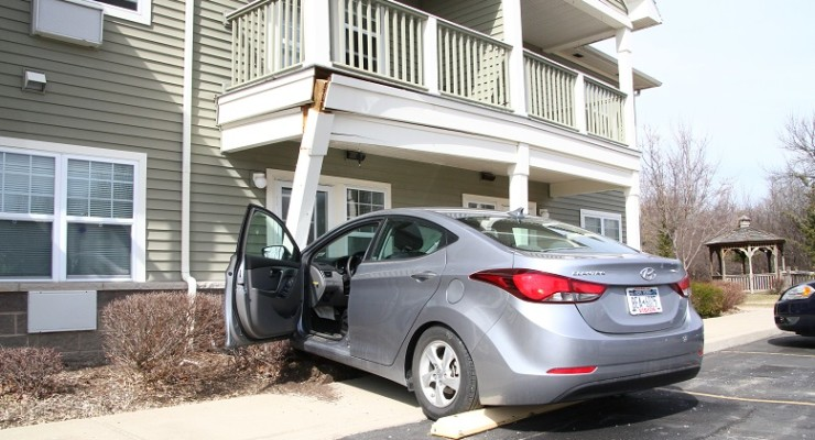Oops! Driver Guns it into Geneseo Porch