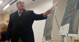 Kirk Rappazzo of MRB Group goes over a flood map in Avon. (Photo/ Josh Williams)