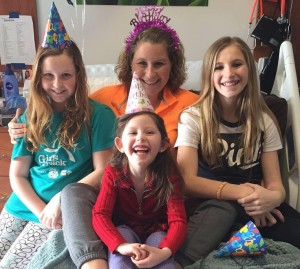 Pam Edwards at center with her three daughters. (Photo/Pam Edward's Facebook page)
