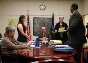 Mary Rutigliano and Matthew Cook are sworn in by Geneseo Clerk/Treasurer Marsha Merrick. (Photo/Sarah Simon)