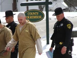 Brandon Rosa being led to jail after sentencing. (Photo/Conrad Baker)