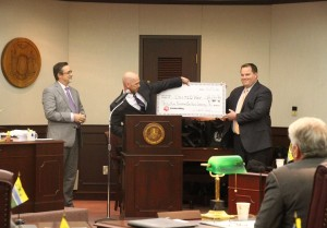 Bassett and Snyder present Van Allen with the check. (Photo/Conrad Baker)