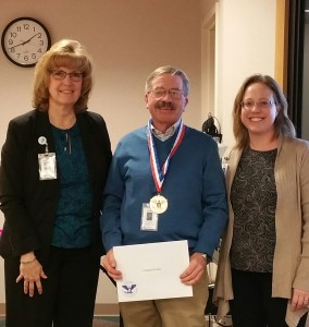 L to R: Patty Piper, Director Community Outreach; Graham Frazer, Volunteer President's Award Recipient; and Christa Barrows, Noyes Volunteer Coordinator.