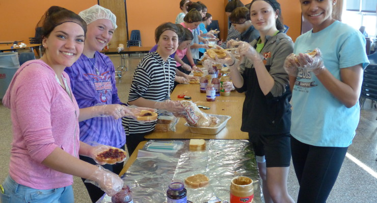 Night of 1,000 PB&J's, Livonia Track Team Helps Stomp Out Hunger