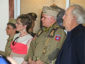 (Foreground) (L-R) Dawn Schaible, Director of Planning & Government Affairs at the museum, Scott Clark with the H Company 505th 2nd Airborne, and Museum President Austin Wadsworth. (Photo/Conrad Baker)