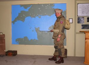 Clark gives a briefing on the D-Day mission. (Photo/Conrad Baker)