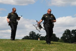 Chief Deputy Jason Yasso carries the <>from the field. (Photo/Conrad Baker)