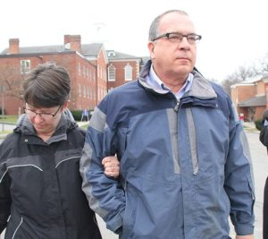 Alan Fox and his wife Cathy walk from the courthouse after the guilty plea in 2014. (Photo/Josh Williams)