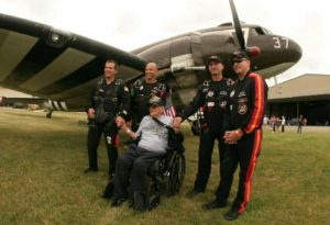 The team with Cruise and Whiskey 7. (Photo/All Veteran Parachute Team)