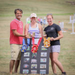 Olympic medalist Darren Chiacchia, GVH staff member and horse trials secretary Kathleen Kirkwood, and EquiCenter, Inc. Program Manager Lindsay Alberts (L-R) display prizes for new Donald T. Holland Memorial Team Challenge. Photo courtesy of Paul Rehbock.