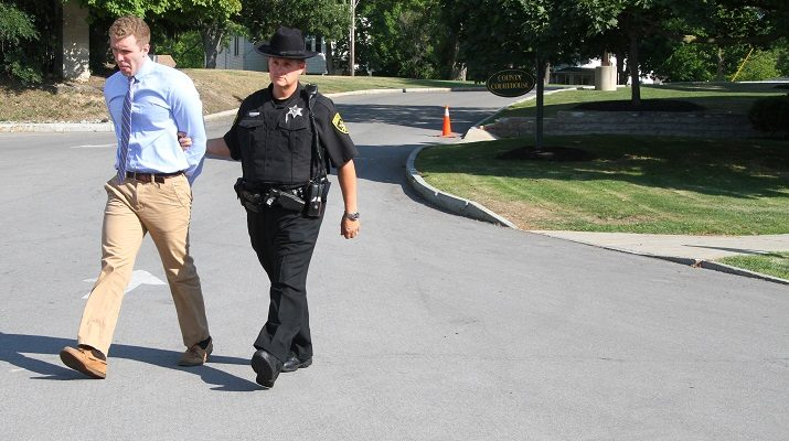 Dahlberg escorted from an earlier court appearance by Deputy Michael Hillier. (Photo/Conrad Baker)