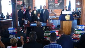 Governor Cuomo signs the law. (Photo/News10NBC)