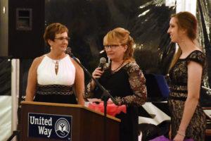 United Way of Livingston County Director Karen Rumfola presents the Gertrude Houston award.