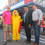 Members of the Rochester Area Community Foundation with APOG's Kurt Cylke (far left) and Lucky Clucky the Chicken. (Photo/Conrad Baker)