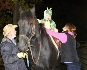 A ride on a ghostly black horse on Halloween. What could be better? (Photo/Conrad Baker)