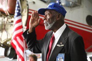 Herbert Thorpe salutes the colors. (Photo/Conrad Baker)
