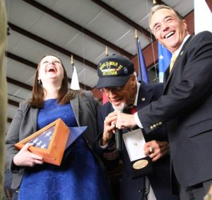 Wallace Higgins receives his replica medal from Rep. Collins and Alison Hunt. (Photo/Conrad Baker)