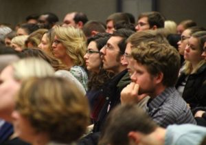 Student and Geneseo Village Trustee Mary Rutigliano (center) watches the speakers. (Photo/Conrad Baker)