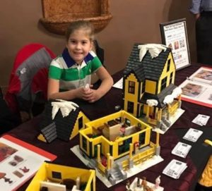 dad and daughter build support to make their christmas story lego house official set - What Year Is Christmas Story Set