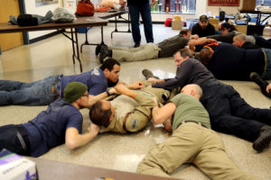 Students prepare to remove a downed comrade during classroom exercises. PHOTO/Andy Diackason