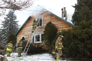 Smoke rises from the windows. (Photo/Conrad Baker)