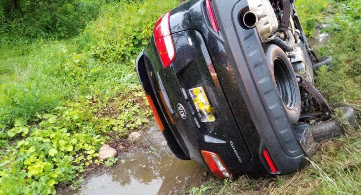 Car Rolls on Bronson Hill Road, Avon