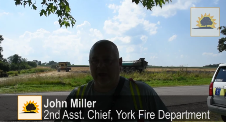 SUN VIDEO: York Farmer and Firefighters Beat Field Fire